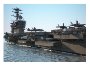 US Military Navy aircraft carrier at sea with vehicles on the deck