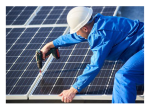 Solar panes being screwed together by man with drill
