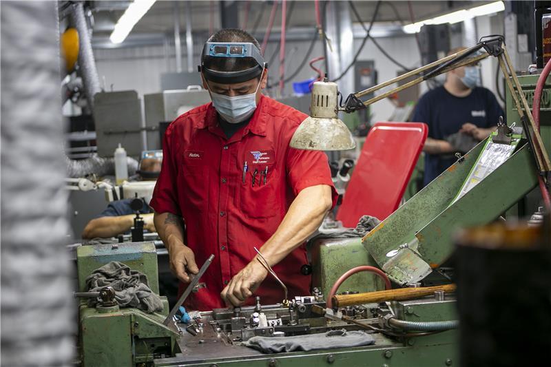 Parker Fasteners staff working at machine